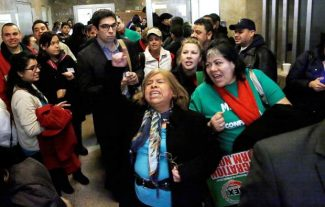 Supporters of granting illegal immigrants drivers licenses cheer after a House committee hearing at the Illinois State Capitol Monday, Jan. 7, 2013, in Springfield Ill. The proposal that could make Illinois the next state to allow illegal immigrants to get driver's licenses has passed out of the House committee. (AP Photo/Seth Perlman)
