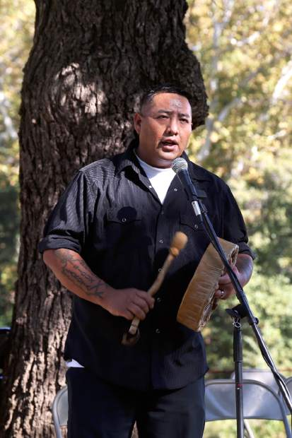 Roland Swallow sings and drums Oglala Lakota songs during the Indigenous Peoples Days celebration at Sycamore Ranch Park in Browns Valley Sunday.