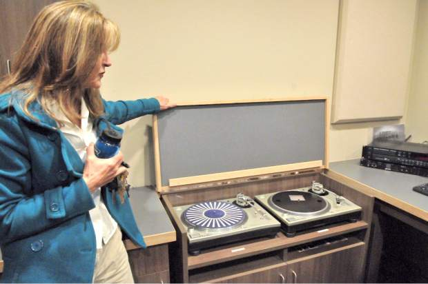 Diane McIntire, owner's representative, shows two turn tables to play vinyl records.