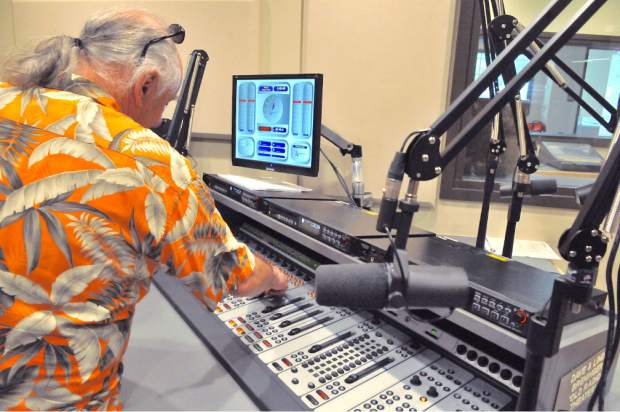 Paul Emery, KVMR's news director, checks out the new broadcast sound board.