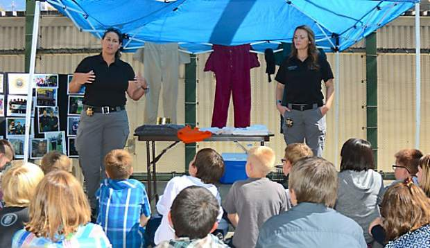 Amy Moon, left, and Melissa Blais of  Nevada County Probation speak with students from Seven Hills School and Sierra Montessori Academy Friday afternoon during the annual