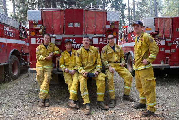 Cal Fire patrols the Lowell Fire from a vantage point and communicates information to fire crews on Saturday.