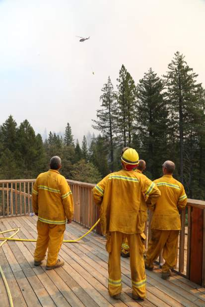 California firefighters at the Lowell Fire in Nevada County on Monday.