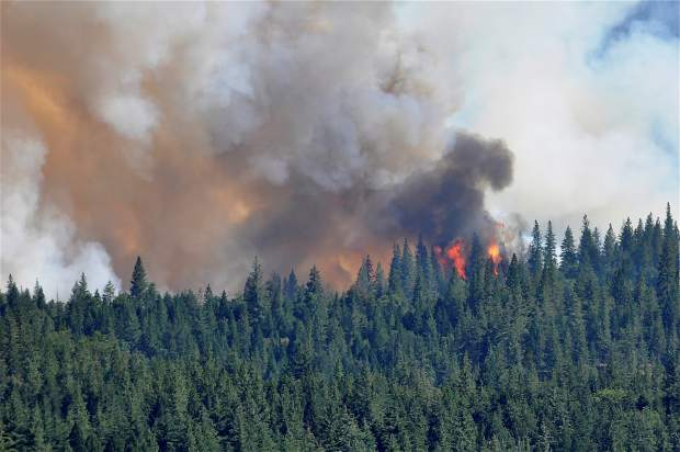 View from Scotts Flat Lake Saturday, as Cal Fire battles the Lowell Fire in the air and on the ground.