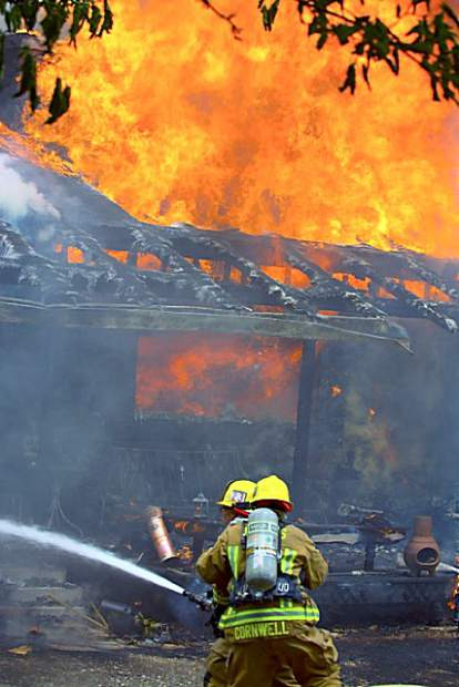 Firefighters battled a structure fire on McCourtney Road in June. Cal Fire, Higgins, Grass Valley, Nevada County Consolidated, and Penn Valley fire departments responded to the fire.