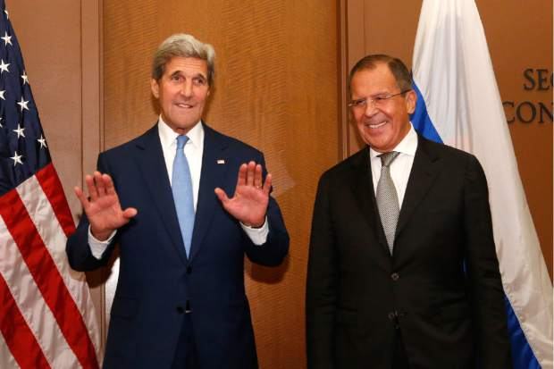 U.S. Secretary of State John Kerry, left, meets with Russia's Foreign Minister Sergey Lavrov at U.N. headquarters, Wednesday, Sept. 30, 2015. (AP Photo/Jason DeCrow)