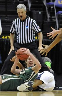 A referee watches as  Cal Poly guard Caroline Reeves, left, looks to make the outlet pass after chasing down a loose ball with Penn State guard Dara Taylor, right, during the first half of a first-round game in the women's NCAA college basketball tournament at the Pete Maravich Assembly Center in Baton Rouge, La., Sunday, March 24, 2013. (AP Photo/Bill Feig)