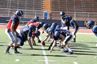 The Nevada Union football team runs through plays while practicing at Hooper Stadium. The Miners kickoff the season Friday at McQueen..
