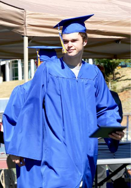 Nevada Union graduate, David Menary, receives his diploma at Hooper Stadium Saturday morning.