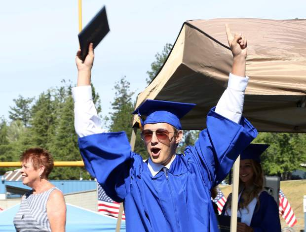 Nevada Union graduate receives their diploma at Hooper Stadium Saturday morning.