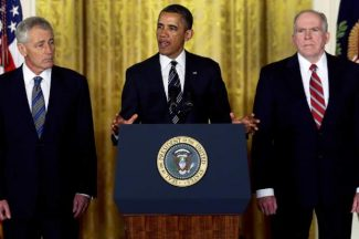 President Barack Obama announces in the East Room of the White House in Washington, Monday, Jan. 7, 2013, that he is nominating Deputy National Security Adviser for Homeland Security and Counterterrorism, John Brennan, right, as the new director of the CIA; and former Nebraska Sen. Chuck Hagel, left, as the new Defense Secretary. (AP Photo/Charles Dharapak)