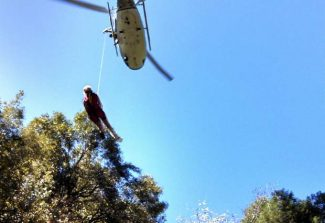 A CHP helicopter lifts an injured hiker out of a steep canyon near Humbug Trail Saturday. The hiker was then transferred to an ambulance and taken to Sierra Nevada Memorial Hospital.