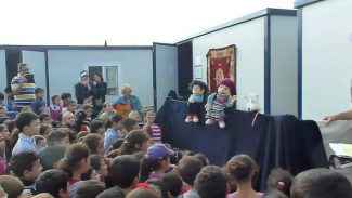 North San Juan resident Tiana Yvonne accompanied members from the Center for Cultural and Naturalist Studies to a Syrian refugee camp in Turkey. Above, she and others put on a puppet show for children living in the camp.