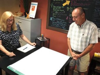 Ellen Persa, campaign coordinator and a Penn Valley Community Foundation board member, and  Bruce Ivy, of Bruce Ivy Construction in Grass Valley, discuss a planned $5M Penn Valley Community Center project Thursday at The Union in Grass Valley.