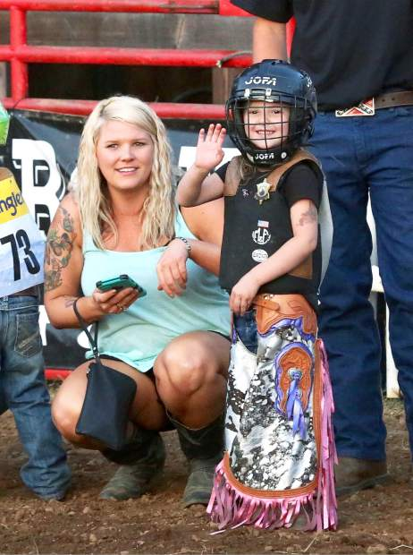 Gemma Kelly prepares for the mutton busting at the Penn Valley Rodeo Friday evening.