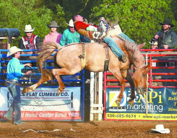 Bucking broncos compete in the Penn Valley Rodeo Friday evening.