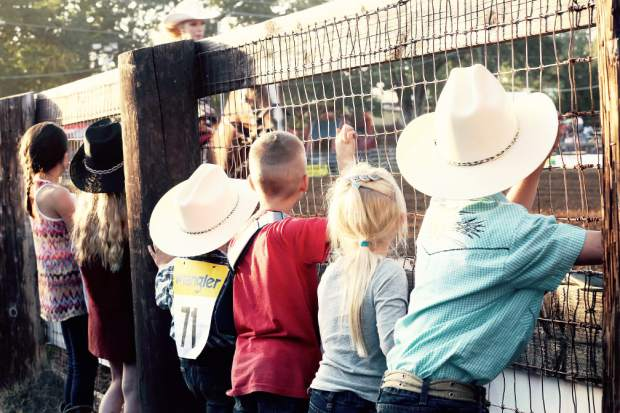 Kids watch the Penn Valley Rodeo Friday evening.
