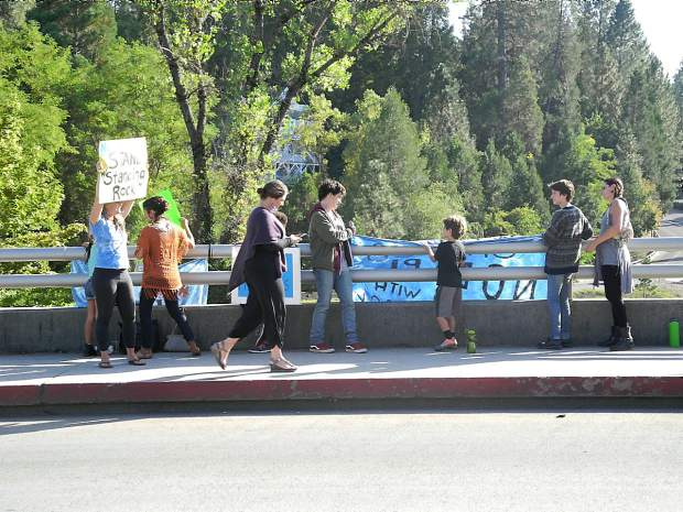 round 40 people joined arms in a demonstration on the Broad Street overpass in Nevada City Tuesday afternoon to support the Standing Rock Sioux tribe's opposition to the construction of the controversial Dakota Access Pipeline by a Texas company. The event, organized by the local chapter of Sierra Club with support from Nevada County Climate Change Coalition and the Peace and Justice Center for Nevada County, was a part of the National Day of Action to show solidarity for the tribal members who voiced concern about the project's impact on their local water supply and sacred sites.