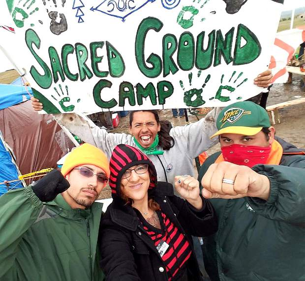 Jennifer Robin with several unidentified protesters at a campsite in North Dakota.