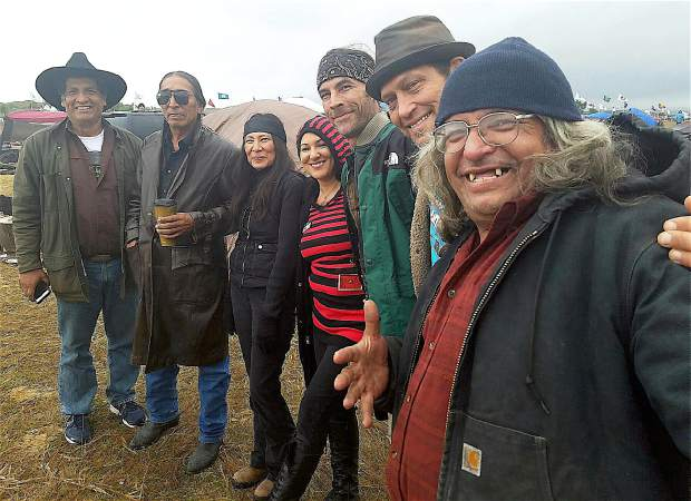 From left, Michael Ben Ortiz, Chief Dave Swallow, Nyla Helper, Jennifer Robin, Chris Jones, Ted Vincent and Gary Christensen, at the pipeline protest.