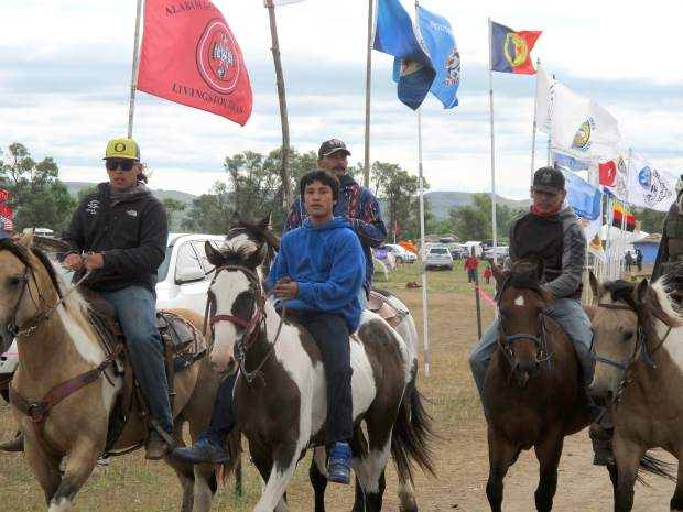 Horseback riders make their way through an encampment near North Dakota's Standing Rock Sioux reservation on Friday, Sept. 9, 2016. The Standing Rock Sioux tribe's attempt to halt construction of an oil pipeline near its North Dakota reservation failed in federal court Friday, but three government agencies asked the pipeline company to