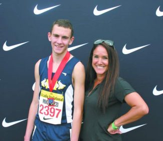 Nevada Union's Garrett Migliozzi stands with track coach Angie Marino at the Arcadia Track and Field Invitational.