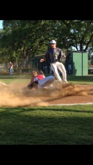Bear River's Jake Sypnicki slides into home during a Friday game against Placer.