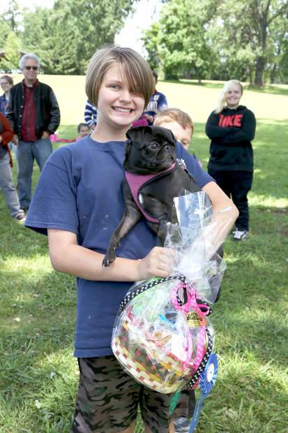 Hannah Nelson's pug, Athena, wins first place in the puppy division of the Pug Sunday Pug Races at Western Gateway Park in Penn Valley Sunday morning.