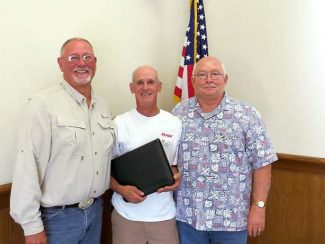 At The Nevada Cemetery District board meeting June 26, David Ray, past board chairman and trustee for the last 24 years, retired from the district board. From left, Nevada Cemetery District Manager Gary Plunkett, David Ray and NCD Chair Dennis Cassella.