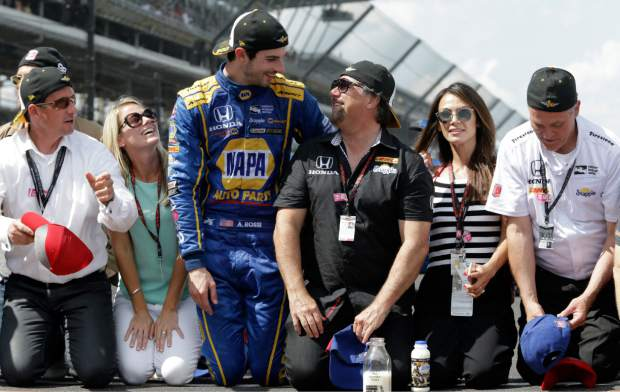 Alexander Rossi, center left,  celebrates with car owner Michael Andretti after winning the 100th running of the Indianapolis 500 auto race at Indianapolis Motor Speedway in Indianapolis, Sunday.