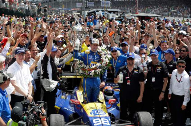 Alexander Rossi, center, celebrates after winning the 100th running of the Indianapolis 500 auto race at Indianapolis Motor Speedway in Indianapolis, Sunday.