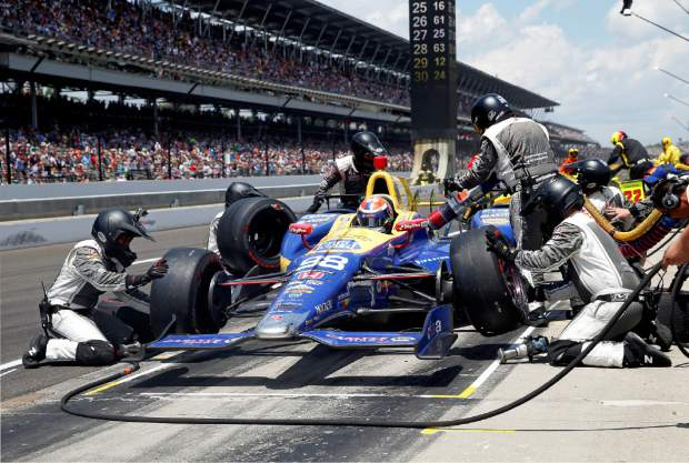 The car driven by Alexander Rossi is serviced during a pit stop in the 100th running of the Indianapolis 500 auto race at Indianapolis Motor Speedway in Indianapolis, Sunday, May 29, 2016. (AP Photo/Rob Baker)