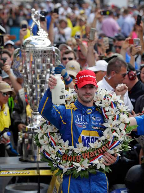 Alexander Rossi celebrates after winning the 100th running of the Indianapolis 500 auto race at Indianapolis Motor Speedway in Indianapolis, Sunday.