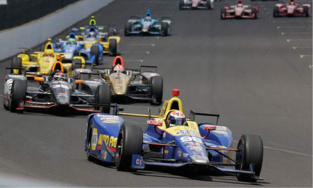 Alexander Rossi leads the field on his way to winning the 100th running of the Indianapolis 500 auto race at Indianapolis Motor Speedway in Indianapolis, Sunday.