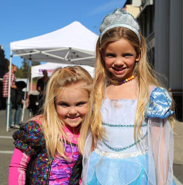 Princess Ashlyn Gomes, left, and Princess Lexi Sidebottom enjoy Safe Trick or Treating in downtown Grass Valley Friday.