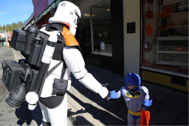 Batman meets a Storm Trooper during Safe Trick or Treat in downtown Grass Valley Friday.