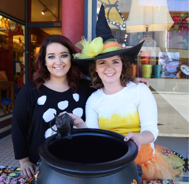 Employees of Yuba Blue distribute candy during Safe Trick or Treat in downtown Grass Valley Friday.