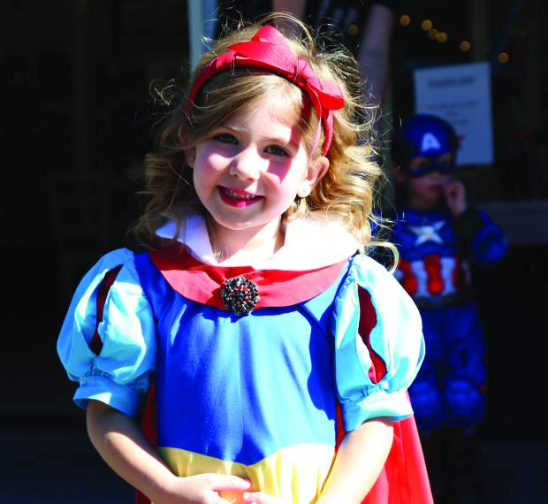 Lola Maupin participates in Safe Trick or Treat as Snow White in downtown Grass Valley Friday.
