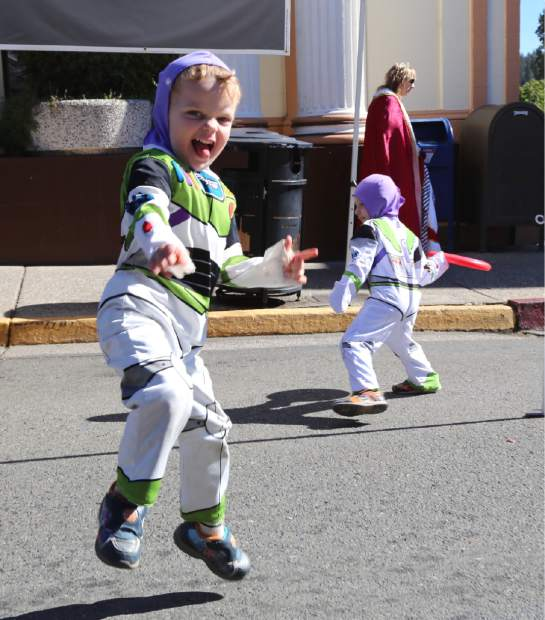 Levi Griffin demonstrates his Buzz Lightyear moves during Safe Trick or Treat in downtown Grass Valley Friday.
