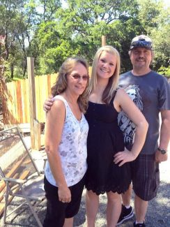 Left to right: Beverly Sample poses with her daughter Amanda and her husband Ron.