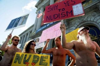FILE  - In this Nov. 14, 2012 file photo, demonstrators gather at a protest against a proposed nudity ban outside of City Hall in San Francisco. A federal judge has cleared the way for San Francisco's ban on most displays of public nudity to take effect on Feb. 1. U.S. District Court Judge Edward Chen ruled Tuesday Feb. 29, 2013 that the city ordinance prohibiting adults from displaying their genitals does not violate the free speech rights of people who like going out in the buff. (AP Photo/Marcio Jose Sanchez, File)