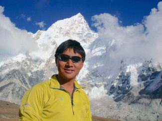 International adventurer Pem Dorjee Sherpa, who raised the Rotary International flag on the summit of Mt. Everest in 2005, is returning to Nevada City for two presentations in early March. Pem Sherpa is pictured in front of Mt. Everest.