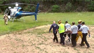 Emergency personnel transport a suspect who sustained two gunshot wounds in an officer-related shooting incident Saturday near Edwards Crossing of the South Yuba River in Nevada County. The incident involved a California Highway Patrol offcer and a Bureau of Land Management officer, who was reportedly doing well after sustaining a gunshot wound to the shoulder.
