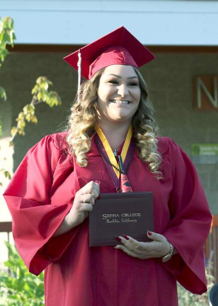 Sierra College graduates receive their diploma during the commencement at the Nevada County campus Thursday evening.