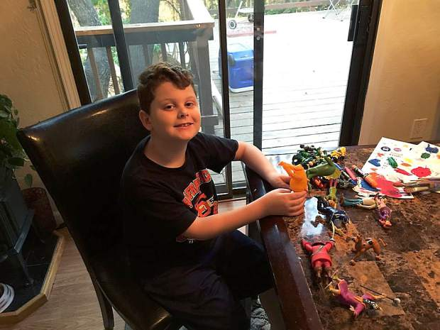 Eight-year-old Silas Hurd plays with toys in his family's Penn Valley home. For the past several months, Hurd's family has been using medical marijuana to control Silas' severe form of epilepsy.
