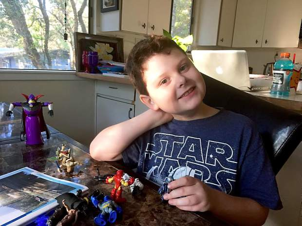 Eight-year-old Silas Hurd in his family's Penn Valley home. For the past several months, Hurd's family has been using medical marijuana to control Silas' severe form of epilepsy.