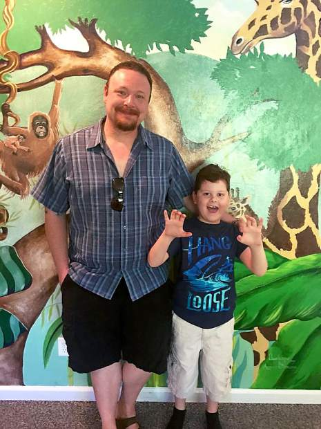 Forrest Hurd with his eight-year-old son Silas at Ridgeline Pediatric Day Health and Respite Services in Grass Valley. Silas Hurd was diagnosed with Lennox-Gastaut syndrome, a severe form of epilepsy, in 2014.