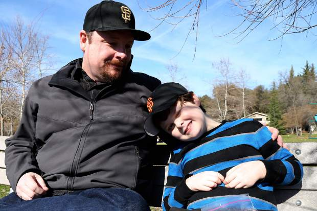 Forrest and Silas Hurd hang out at a park near their home in Lake Wildwood, Penn Valley Friday morning.
