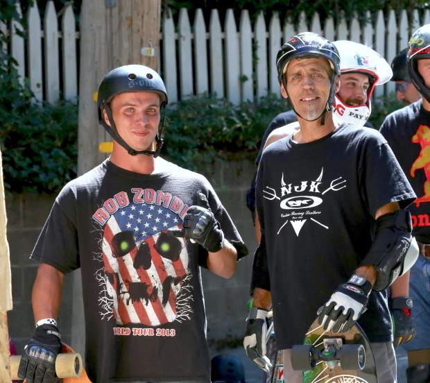 Martin Radan and his son Mike compete in the 2016 Gold Rush Classic Skateboard Race hosted by the N-Men down Nimrod St in Nevada City Saturday.