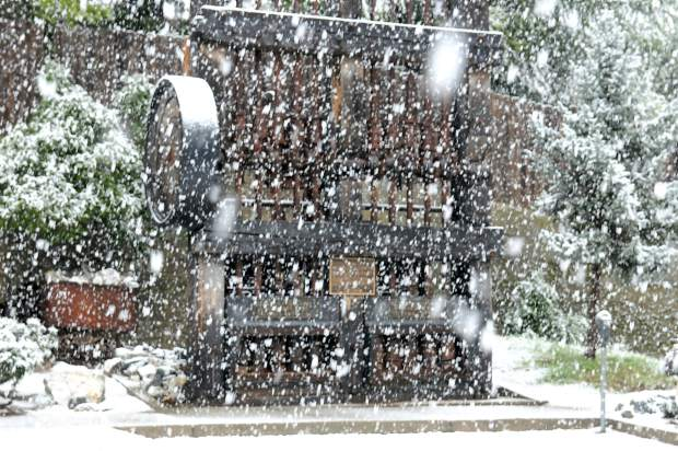 Snow covers the mining stamp mill in the Commercial Street parking lot Tuesday morning in Nevada City.